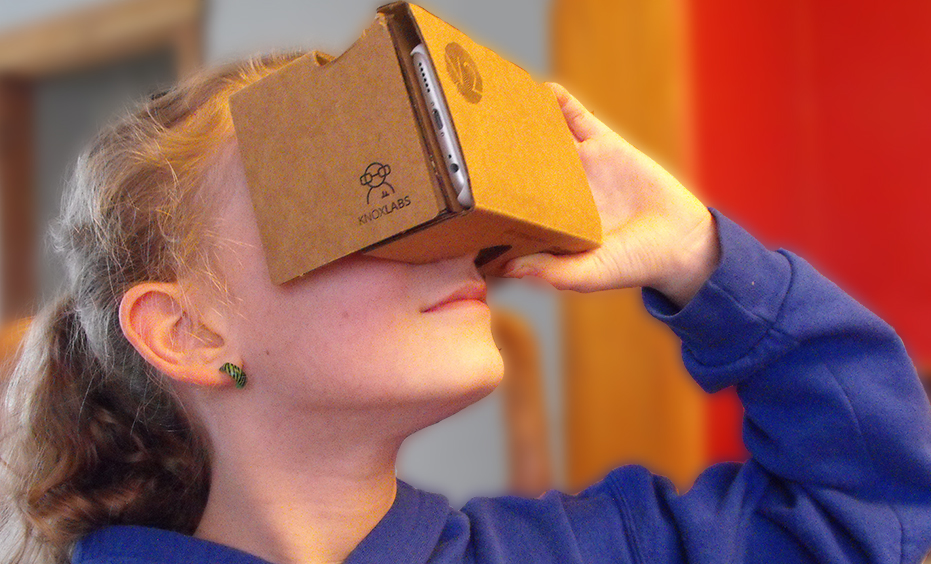 child looking into cardboard 3D viewer