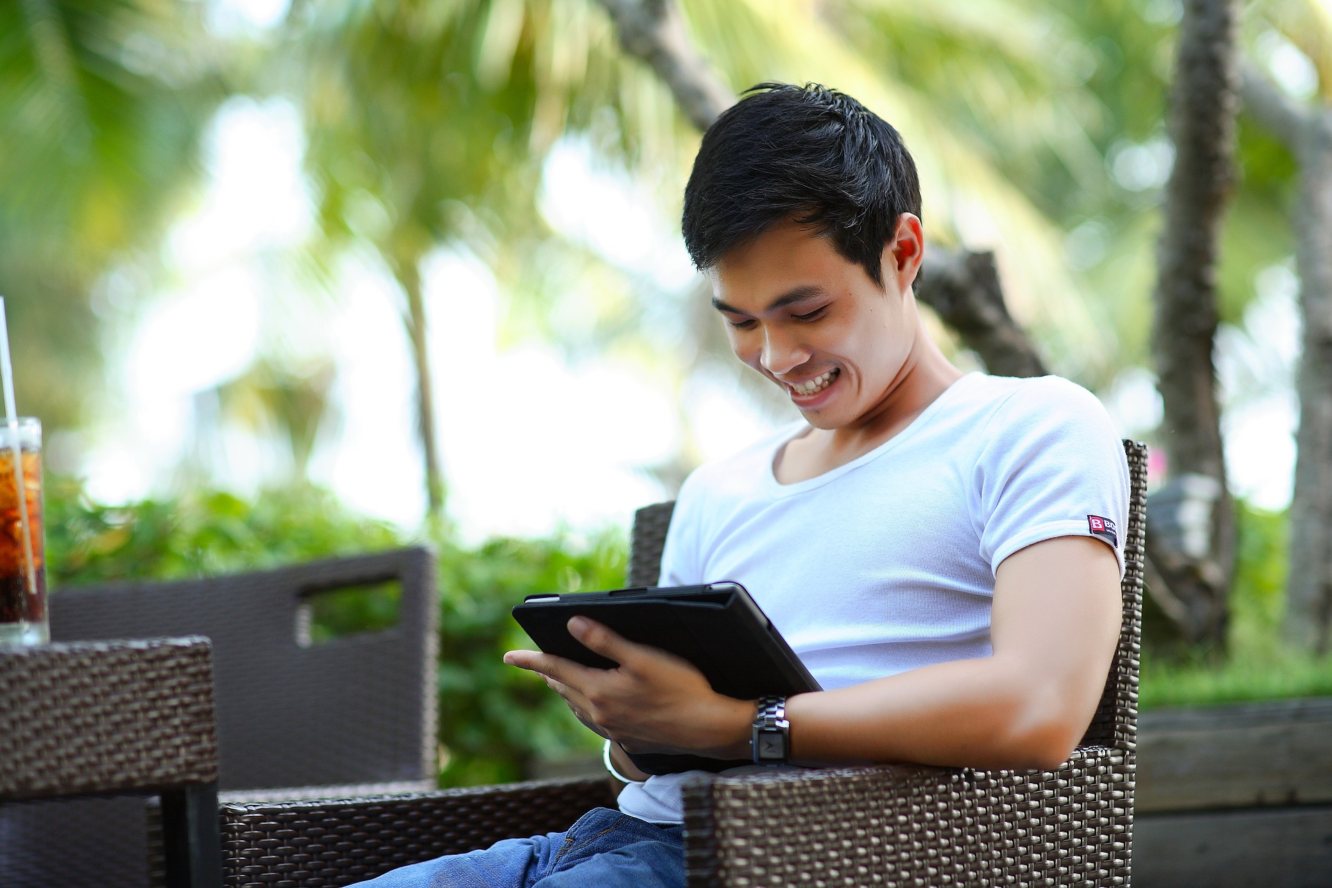 Man on tablet smiling